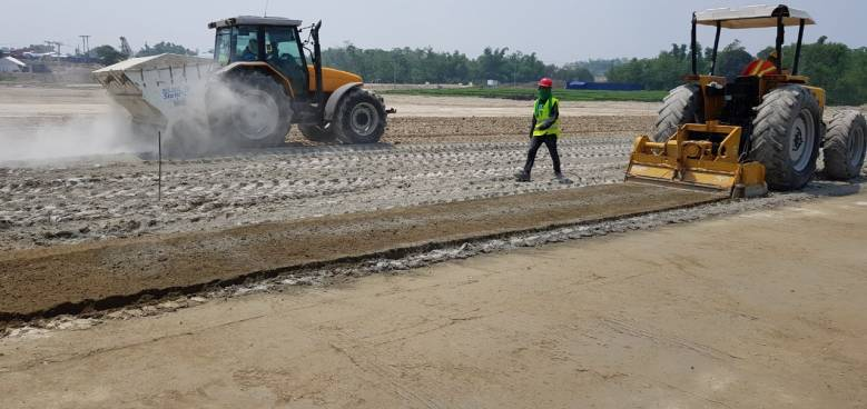 holcim binders to stabilize the soil being applied in the parking lot of the aquatic center
