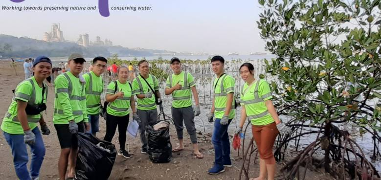 holcim employees at the lugait coast in misamis oriental for international coastal clean up day